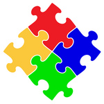 Clipart Illustration of Four Red, Blue, Green And Yellow Puzzle